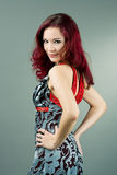 Red haired woman standing backwards Stock Image