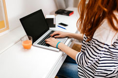 Red haired woman studying stock images