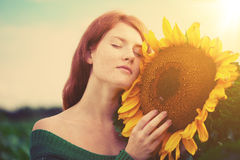Red-haired woman with sunflowers Royalty Free Stock Photos