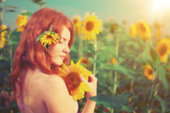 Red-haired woman with sunflowers Royalty Free Stock Photography