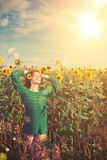 Red-haired woman with sunflowers Royalty Free Stock Photo