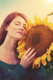 Red-haired woman with sunflowers Royalty Free Stock Image