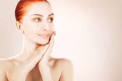 Red haired woman with surgery marks, grey background Stock Images