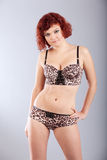 Red haired woman in underwear pose Stock Photo