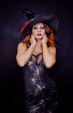 Red haired woman wearing as witch for halloween Royalty Free Stock Photos