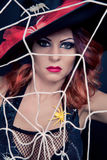 Red haired woman wearing as witch for halloween Stock Photos