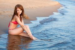Red haired woman wearing bikini Stock Photography