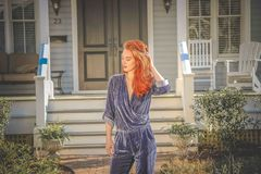 Red Haired Woman Wearing Blue Long-sleeve Jumpsuit Stock Photo