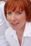 Red haired woman wearing white shirt Stock Image