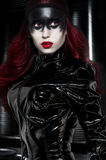 Red haired woman with weird black makeup Stock Photos