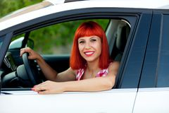 Red Haired Woman With Her New Car Royalty Free Stock Photo
