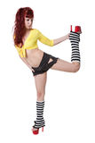 Red-haired woman in yellow blouse and black shorts Stock Photo