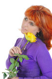 Red-haired woman with a yellow rose. Royalty Free Stock Photos
