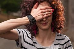 Red haired women hide her eyes by hand Royalty Free Stock Photo