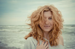 Red-haired women on the seaside Royalty Free Stock Images