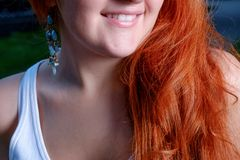 Red haired women smiling. Part of the face Royalty Free Stock Photo