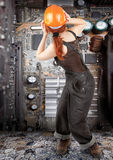 Red-haired worker girl royalty free stock photography