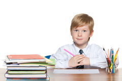 Red-haired young boy at the desk Stock Image