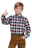 Red-haired young boy holds his thumb up Stock Image