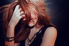 Red-haired young girl with hair fluttering Stock Photography