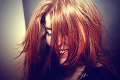 Red-haired young girl Stock Photos