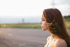 Red-haired young lady at sunset Stock Image