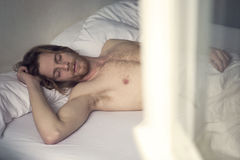 Red-haired young man sleeping in bed Royalty Free Stock Photography