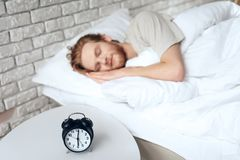 Red haired young man sleeps in bedroom royalty free stock image