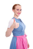 Red-haired young woman in Dirndl with thumbs up Royalty Free Stock Photo
