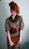 Red-haired young woman in fashion dress witn purse Royalty Free Stock Photo