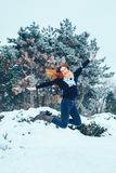 Red-haired young woman with a red scarf in a winter forest Royalty Free Stock Photo