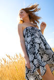 Red-haired young woman in wheat field Royalty Free Stock Photo