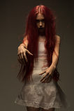 Red haired zombie woman. In white cotton dress Stock Photos