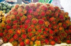 Red hairy and spiny rambutan , type of tropical fresh fruits stock image