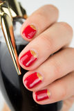 Red half moon nail art manicure. Close up royalty free stock photo