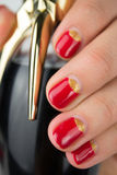 Red half moon nail art manicure. Close up stock image