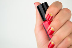Red half moon nail art manicure. Close up stock photography