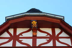 Red half-timbered beams. Partial view of house with red half-timbered beams Royalty Free Stock Photo