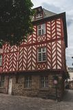 Red half-timbered house. Historic red and white half-timbered house currently serves as tourist office in Rennes, Brittany, France Stock Photography