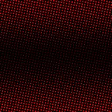 Red halftone on black background. Red dots on black background Royalty Free Stock Photography