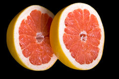 Red halved grapefruit Royalty Free Stock Image