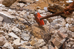 Red hammer pound concrete in construction site Royalty Free Stock Image