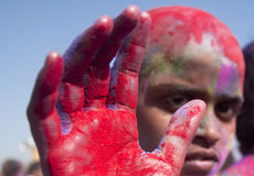 Red hand. Boy showing his hand painted red Royalty Free Stock Image