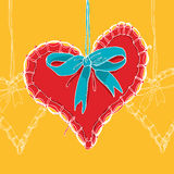 Red hand drawn heart with blue bow Royalty Free Stock Photography