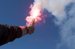 Red hand flare, distress signal. Red hand flare - a distress signal both at sea and land Stock Photo