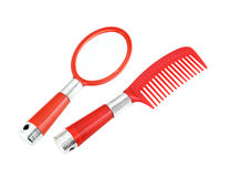Red hand mirror and comb Royalty Free Stock Photos