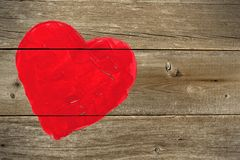 Red hand painted heart on rustic wood Royalty Free Stock Images