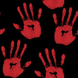 Red hand prints on black background Royalty Free Stock Photos