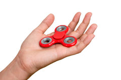 Red hand spinner. Boy playing a popular toy fidget spinner in his hand. Stress relief. Anti stress and relaxation adhd attention f. Ad boy concept stock photos