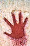 Red hand on stone - graphic gothic element stock images